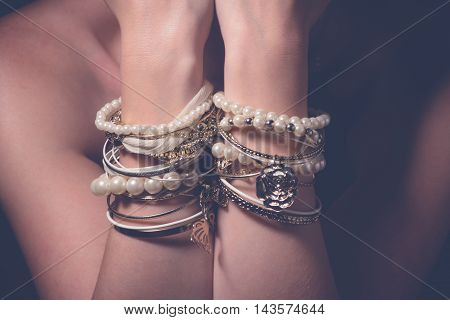 Collection of bracelets on the hands of a woman