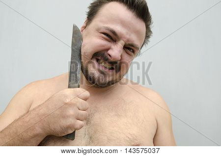 Man holds a knife at the cheek