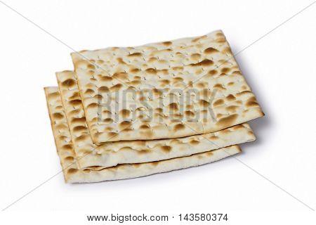 Multiple machine made matza flatbreads lying one over another composition isolated over the white background