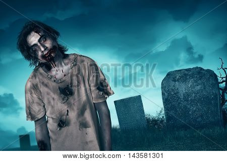 Zombie walking with creepy expression graveyard and fog background