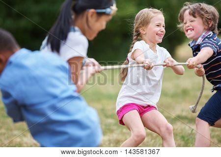 Group of kids playing tug of war