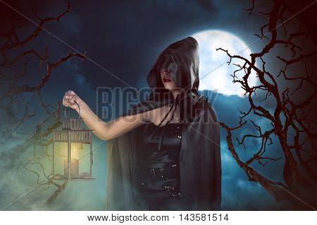 Asian Witch Woman Holding Lantern