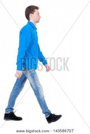 Back view of going  handsome man. walking young guy . Rear view people collection.  backside view of person.  Isolated over white background. Curly boy in blue sweater goes sideways.