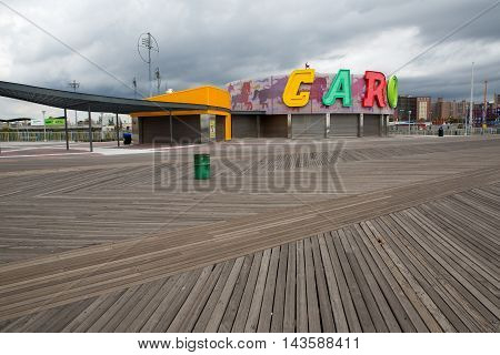 Boardwalk view to the amusement park in the Coney Island New York
