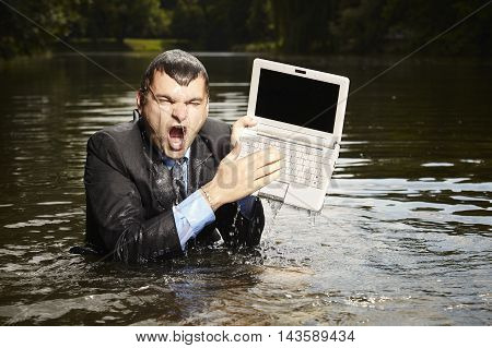 Crazy businessman in suit - deep in water - accident