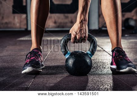 fit kettlebell training in gym closeup. Black and white