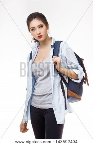 Portrait of teenager girl with school backpack isolated on white background. Good for sport and travel concept