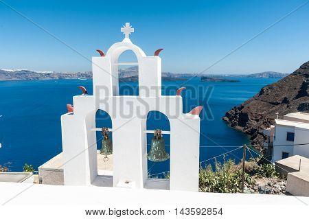 White bell tower in Thirasia - Santorini - Greece
