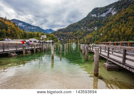 Famous lake Konigssee. Mooring for tourist pleasure boats.  Berchtesgaden in Germany on the border with Austria