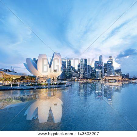 Singapore, Republic of Singapore - May 3, 2016: Panorama of Marina Bay with Artscience lotus flower museum glowing at night