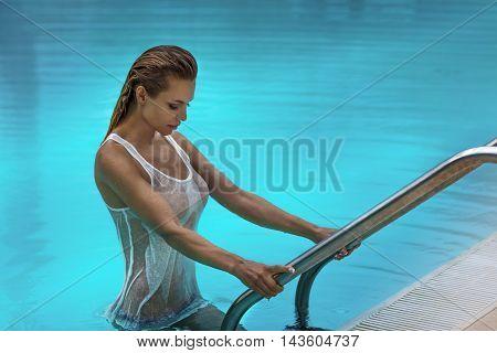 Sensual Blonde Woman In Swimming Pool.
