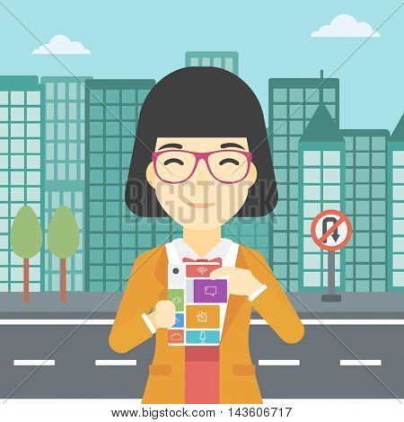 An asian woman holding modular phone. An asian woman with modular phone standing on a city background. Woman using modular phone. Vector flat design illustration. Square layout.