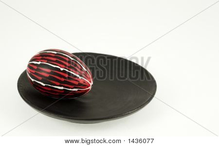 Colored Egg On A Black Plate