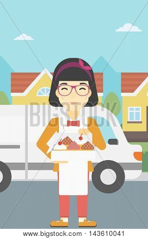 An asian  female baker holding a box of cakes. A baker delivering cakes. Baker with cupcakes standing on the background of delivery truck. Vector flat design illustration. Vertical layout.
