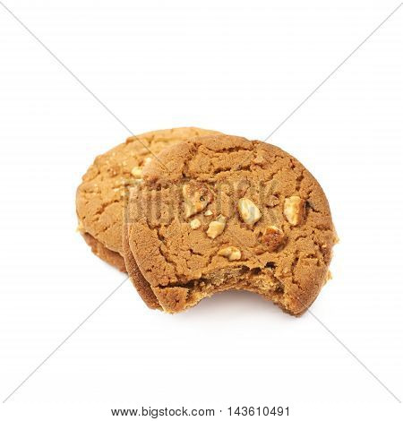 Two peanut butter homemade cookies with a bite taken of it, composition isolated over the white background