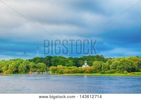 Summer landscape - Volkhov river and Church of St. John the Evangelist on Vitka river in Veliky Novgorod Russia.