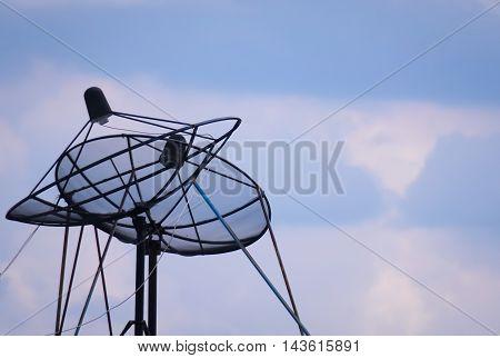 Satellite dish antenna isolated on sky background