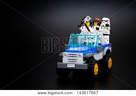 Group o Star Wars Lego Stormtroopers mini figures take a selfie in a car. Lego is a popular line of construction toys manufactured by the Lego Group