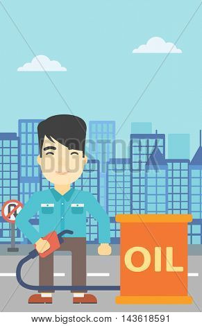 An asian man standing near oil barrel. Man holding gas pump nozzle on a city background. Man with gas pump and oil barrel. Vector flat design illustration. Vertical layout.