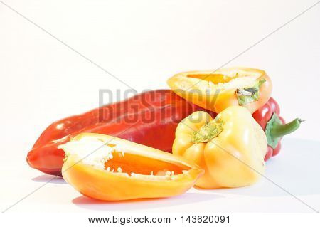 Beautiful red and yellow peppers, isolated on white background