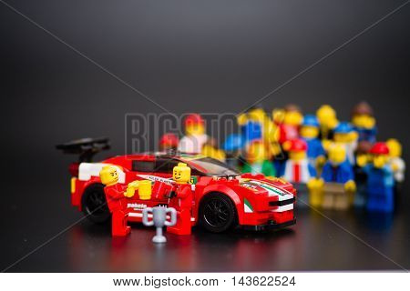 Orvieto Italy - January 17th 2015: . Lego minifigure drivers of Ferrari racing car celebrating the victory. Lego is a popular line of construction toys manufactured by the Lego Group