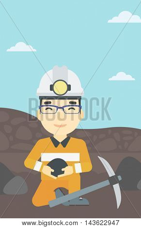 An asian miner  in hard hat sitting with coal in hands and a pickaxe on the background of coal mine. Vector flat design illustration. Vertical layout.