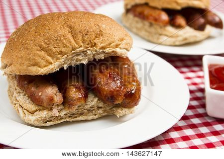 Sausage sandwich A traditional British sausage sandwich in a bun