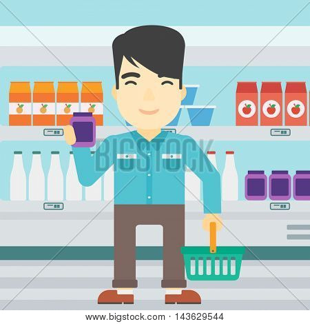 An asian young man holding shopping basket in one hand and a milk product in the other. Male customer shopping at supermarket with basket. Vector flat design illustration. Square layout.