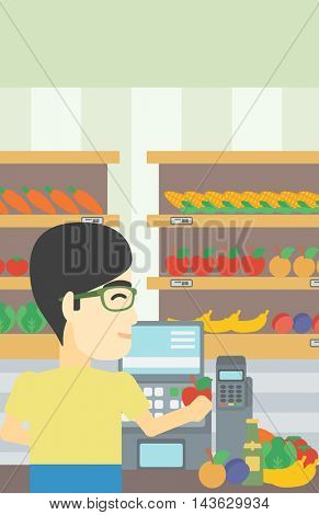 An asian young male cashier standing at the checkout in supermarket. Male cashier working at checkout in supermarket. Vector flat design illustration. Vertical layout.