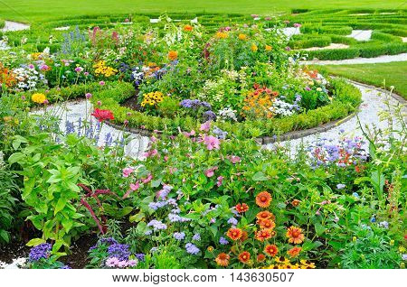 A summer flower bed and green lawn