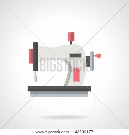 Sewing machine with round handle of manual control. Household equipment for home tailoring, hobby, needlework. Flat color style vector icon.