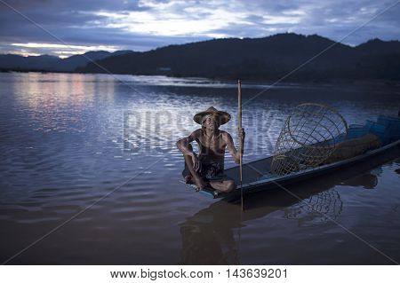 The old man is a traditional fishing. In the Mekong river basin countries Thai-Laos.