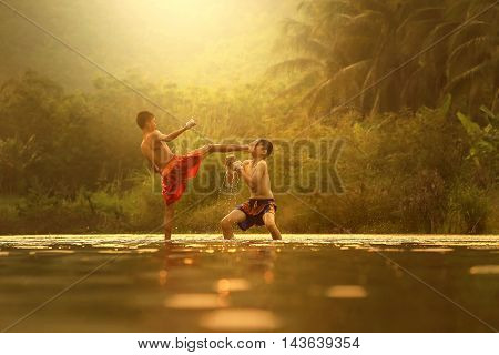 Muay thai fighting on the river Countryside Thailand