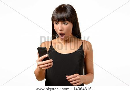 Horrified Young Woman Looking At Her Mobile