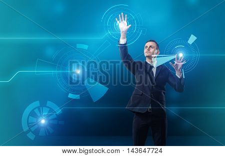 Businessman touching digital touchscreen with both hands. Innovative technologies. Global business. Cyberspace and virtual reality. Concepts and ideas.
