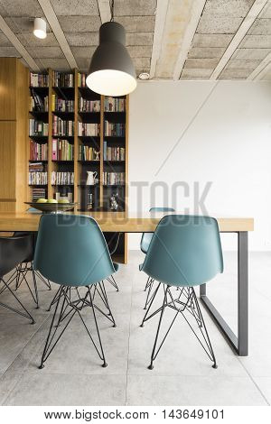 Photo of a dining room in a modern apartment with post industrial decor
