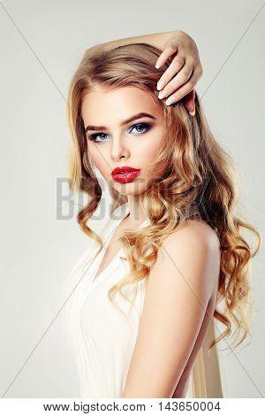Sensual Woman Fashion Model. Blonde Wavy Hairstyle. Makeup