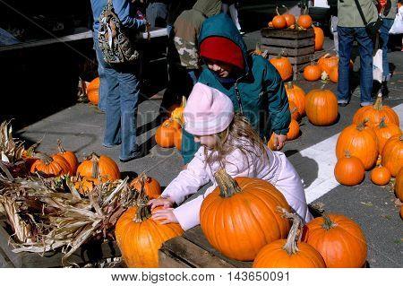 New York City - October 29 2006: Children choosing their Halloween pumpkin at the annual West 100th Street Fall Festival
