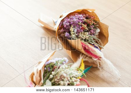 Top View Of Bouquets Of Flowers On Wooden Background