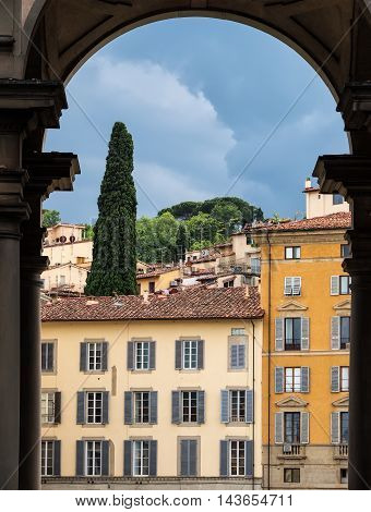 View from an archway the colorful italian architecture in Florence Italy.