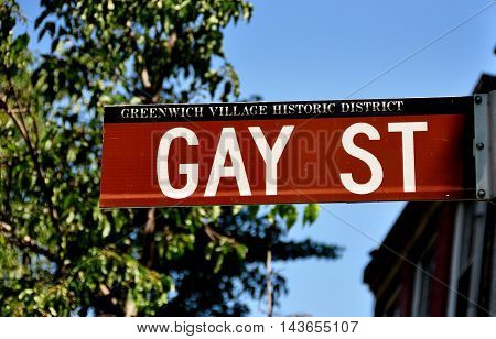 New York City - June 19, 2013:  The Gay Street sign at the corner of Christopher Street in the heart of Greenwich Village