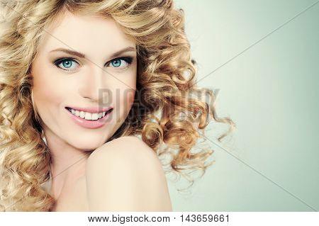 Beauty Portrait of Happy Girl on Light Green Background