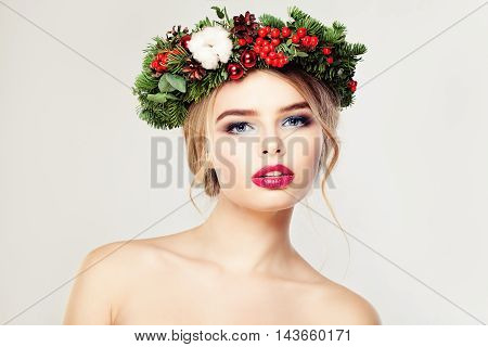 Christmas Woman. Cute Face. Healthy Skin. Makeup and Xmas Tree Wreath