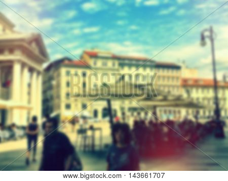 Blurred city life of Trieste - Italy. People walking in a hystoric square in the middle of the city.