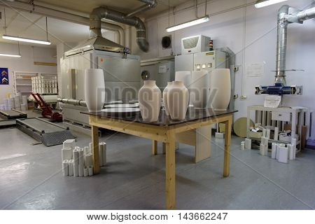 ST. PETERSBURG, RUSSIA - AUGUST 9, 2016: Production of Imperial porcelain manufactory in workshop. Founded in 1744 by order of Empress Elisabeth, now the factory produces about 4000 items