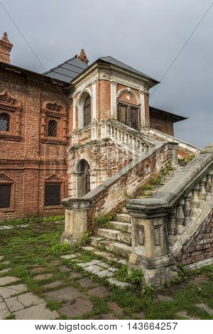 Old house with stairs. Gloomy house with ghosts. Stock Photo.