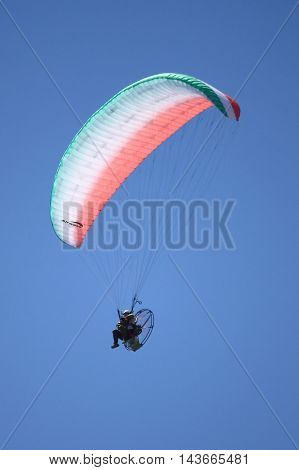 ROME - JUNE 3: A powered paraglider perform at the Rome International Air Show on June 3 2012 in Rome Italy