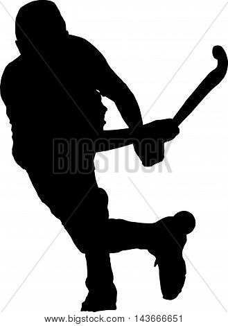 Silhouette Of Boy Hockey Player Hitting Ball