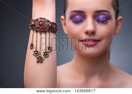 Beautiful woman with jewellery in fashion concept poster