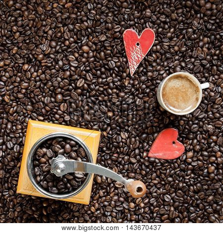 Cup of coffee on fresh roasted coffee beans